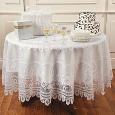 "ROUND WHITE LACE TABLECLOTH  - Per OTC, ""Use to accent the sweetheart table, dessert table, gift table or the buffet. Polyester. 84"" diam. Hand wash, do not bleach.""  -- A 11/2014 ""R"" wrote, ""Have used them over and over.  They hold up well to washing in cold water and a cool dryer. They come out ready to go on the tables again. They are a heavier material so they lay well on the tables. I wish I could get the same kind in an 8 foot rectangle for my other tables."""