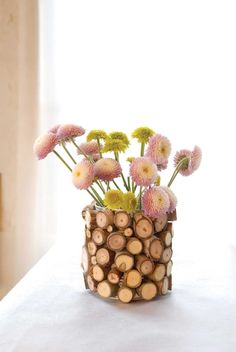 Create your own eco-friendly décor byusing wood chips to liven up terra cotta pots, old vases or recycled tin cans.data-pin-do=
