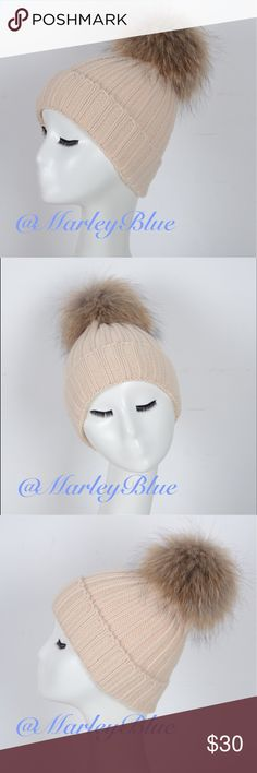Beautiful Beige Knit Hat with Genuine Fur Pompom Just amazing!! Beige knitted hat with oversized raccoon fur pompom.  High quality, thick hat...will keep you warm in the coldest weather. Pompom is easily detachable so that hat can be washed. Brand-new hat. 30% wool 70% acrylic.  Please check out the rest of my closet. 20% off 2 or more items!! Accessories Hats