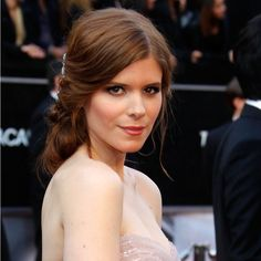 "There are enough details surrounding your wedding to make you nervous; you don't need the added stress of trying a new haircut. ""This is really great for those with long hair, because it gives the illusion of side-swept bangs without having to actually cut any layers,"" Cranford says. That's all thanks to an embellished clip fastened behind Kate Mara's right ear. ""You wouldn't want to put it on the side opposite of the bun,"" she says. ""This helps to secure everything."""