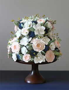 Quite the confection by @Rachel City Cakes: Wow, that's beautiful! Perfect for a springtime wedding.