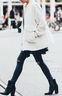 White coat, ripped jeans and cute ankle boots