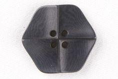 Black Plastic button from Mood Fabrics - interesting shape