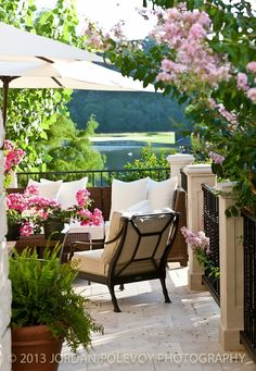 Pretty shaded out door space to sit surrounded by blooms is the epitome of summer style