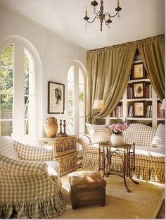 Gorgeous formal living room with great arched windows and a way to soften a bookshelf