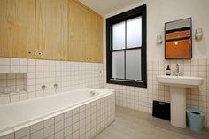 Grid tiles in small bathroom