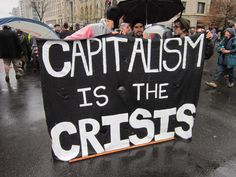 """""""Capitalism is the crisis""""    [click on this image to find a clip and analysis that considers the way class politics are a central feature of the wrangling about how to pay down the government budget deficit]"""