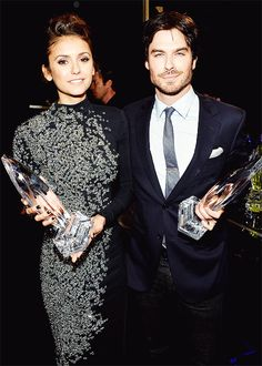 Ian Somerhalder and Nina Dobrev, winners of the Favorite On Screen Chemistry award for 'The Vampire Diaries,' attend The 40th Annual People's Choice Awards
