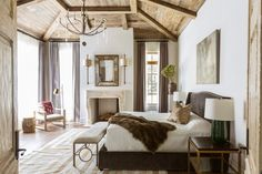 bedroom in a neutral palette and with rustic touches. Marie Flanigan Interiors