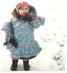 #Inuit child wearing #parka. This cotton fabric protects the wool duffle that is under the parka. eskimo