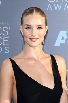 Rosie Huntington-Whiteley has often shown her penchant for seamlessly combining sexy and elegant for eye catching appearances. And, at the 2016 Critics' Choice Awards held at the Barker Hangar on January 17, 2016 in Santa Monica, California, she was at her sultry elegant best as she flaunted her supermodel figure in a floor-length backless gown, complete with a split almost to her hip on the skirt....