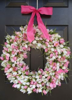 "Pink and White tulips will bring a smile to anyone's face that sees this big wreath.  Full over artificial tulips on a 16"" grapevine wreath. Big and Beautiful."