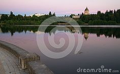 The state capital reflects in the lake of the same name at dusk in Olympia, Wa