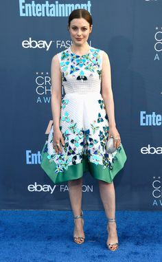 The Love actress added a touch of turquoise to the show in this white, patterned frock.