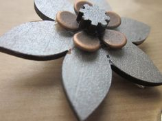 Hair clip Wood and metal flower £7.00