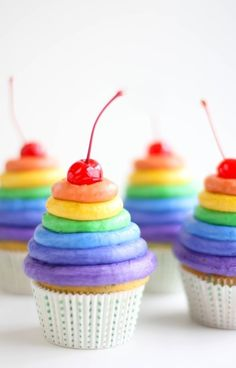 I was thinking of these for Madison and Ella's party.Cupcakes...cute for a rainbow party
