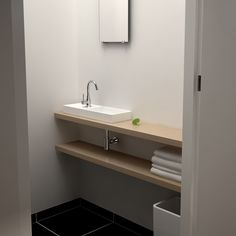 Clou - 'Mini Wash Me' concept toilet. We used two pearl oak shelves of 140 cm on the top shelve we placed a 'Mini Wash Me' 56 cm left version made of white ceramics.