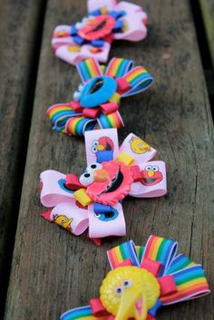 Sesame Street Inspired Hair Bows Choose your ribbon colors and center. $5.00, via Etsy.