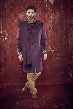 Velvet Indowestern Sherwani embellished with zardosi, zari and sequins work on collar and sleeves, styled with de- attachable shawl