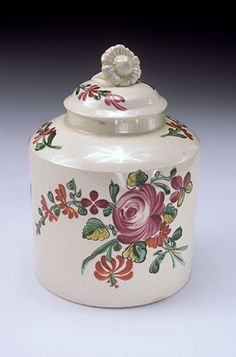 English Title:	tea canister Date Made:	1775-1790 Materials:	ceramic: lead-glazed cream-colored earthenware (creamware) with overglaze enamels Place Made:	United Kingdom;