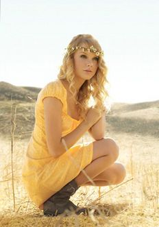 Taylor Swift - love the hair, hair wreath, yellow dress & boots.