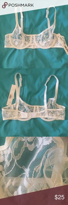 Unlined DKNY lace bra Delicate unlined lace bra by DKNY will keep you supported and stylish! This bra features creamy white lace all over with a Demi cup shape. Excellent condition, brand new and never worn! DKNY Intimates & Sleepwear Bras