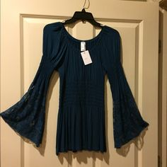 NWT L&B Top Beautiful teal blue soft top with lace bell shaped sleeves. Dress up with a long skirt or dressy slacks OR pair with jeans and heels for a night out. L & B Tops Blouses