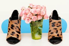 i just love this photo. the shoes, flowers, and vase make an amazing palette.