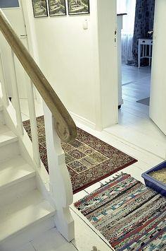a white floor in a corridor