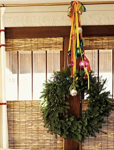 wreath hanging by colored ribbons