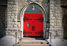 Red Doors, Gothic arch and divine iron work hinges.