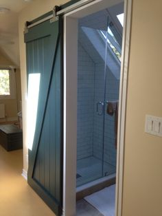 green barn door for attic bathroom