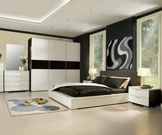black bedroom wall paint with black and white bed and cupboard