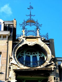 loveisspeed.......: Gustave Strauven (Schaerbeek, 1878 - Haute Savoie, 1919) was a Belgian architect.His work of Maison Saint-Cyr is well known..It is his most important building built between 1901 and 1903 in a baroque-flamboyant style. It was built to be Georges de Saint-Cyr's private residence. It is four metres long and it has a good deal of wrought iron in the façade, which is adorned with geometric motifs and each balcony has a balustrade. The wrought iron mimics vegetation and the…