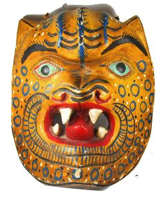 How about some folk art from their favorite country, like this vintage Mexican mask!