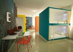Emanuel Hostel in Split, Croatia, with colourful bunk bed booths and graphics on walls by Lana Vitas Gruić and Toni Radan. Hostels, Bunk Beds With Stairs, Hotel Restaurant, Student House, Dormitory, Interiores Design, Bed And Breakfast, Interior Architecture, Restaurants