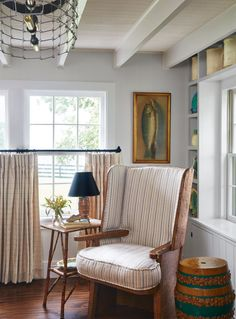 Not wanting to obstruct views of the farm but still desiring texture and a bit of privacy, the owner of this farmhouse made a clever curtain call: Hang the drapes at the center of the window for the best of both worlds.