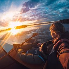 Photo of the Day! @elsarojerfeldt and @marcuswicander kayaked out on #OrsaLake to enjoy the #sunset, only to have him fall asleep in her lap! # Share your favorite moments with us via #GoProAwards. #GoPro #GoProNaps