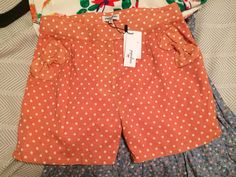 "Modcloth peach and cream polka dot shorts with bow details on the pockets! I couldn't find the Modcloth link for this. Marked Size S, but with 30"" waist. 11"" rise from waistband to crotch. 27 glitters shipped."