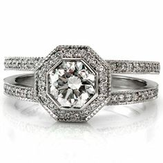 This beautiful diamond engagement ring has a split shank band with an octagonal halo around a radiant cut center diamond. Both the halo and the band are done in micro pave. Design 1548 from Knox Jewelers