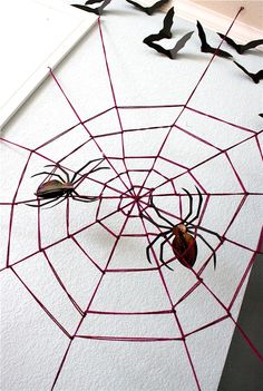 WALL SIZE spider web made from yarn. Hmmmm....10 minutes? Give me an hour maybe! Really good tutorial here. #halloween