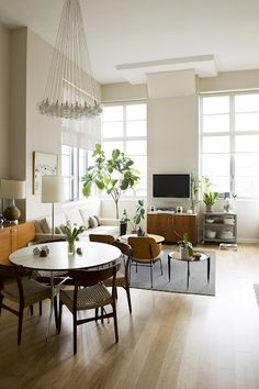 midcentury, check out this light bulb chandelier in this room!