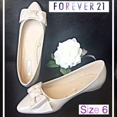 Forwver 21 F21 Sweet Cream Ballet Flats 6 Forever 21 sweet little ballet flats. Neutral cream patent leather  upper - adorable fabric bow accent - lightly padded footbed - only worn once excellent condition - size 6. Pair with your favorite jeans, shorts, skirt or dress for a sweet feminine look. Forever 21 Shoes Flats & Loafers