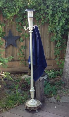 So, I totally wanted to use this lamp in the house but repurposed it into towel/clothes rack for use outside with the hot tub. Not bad for $5. :0)