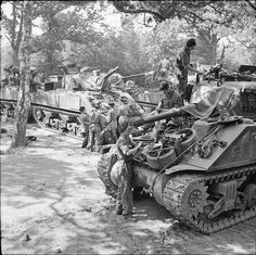 Sherman tanks crews of C Squadron, Royal Hussars, prepare their vehicles on 30 May 1944 for the upcoming invasion of Normandy. Normandy Invasion, Sherman Tank, Ww2 Tanks, D Day, British Army, World War Two, Military Vehicles, Wwii, Ww2 History