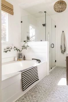 Reveal: Boho Farmhouse Master Bathroom Remodel with Decor Sources. Bathroom with white subway tiles, white& The post Reveal: Boho Farmhouse Master Bathroom Remodel with Decor Sources appeared first on England Gardens. Bad Inspiration, Bathroom Inspiration, Design Living Room, Living Rooms, Master Bath Remodel, Remodel Bathroom, Bathroom Remodel Pictures, Tub Remodel, Bathroom Images