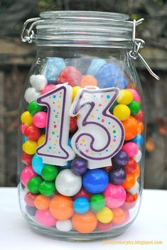 Birthday centerpiece idea for any age -- tie balloons on top -- fill with any candy