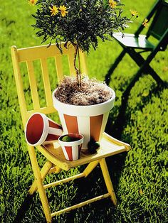 Spruce up your plain terra-cotta pots with painted stripes. Very cute and doable!