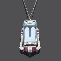 An art deco aquamarine, diamond and ruby brooch/pendant, circa 1935  The central step-cut aquamarine within a brilliant-cut diamond border highlighted with trapeze and baguette-cut diamonds and calibré-cut rubies, to a fine trace-link chain, one diamond a rose-cut replacement, pendant length 4.3cm., chain length 70.0cm.