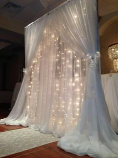 Get 4 x 8 foam boards paint purple and then place white tulle and lights in front